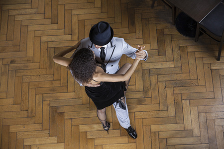 angle: High angle view of man and woman performing tango in restaurant