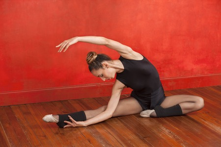 Full length of dedicated ballet dancer practicing in dance studio Stock Photo