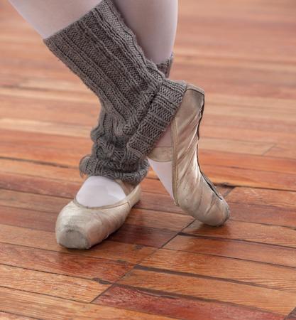 hardwood floor: Low section of ballerina performing on hardwood floor
