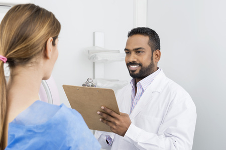 Doctor Talking To Patient Before Mammogram X-ray Test