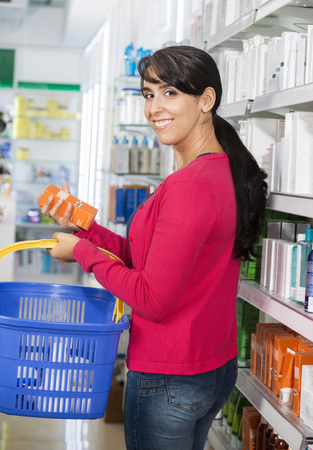 Portrait Of Woman Shopping Cosmetics In Pharmacy