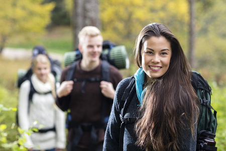 staycation: Portrait Of Beautiful Young Woman Hiking In Forest Stock Photo