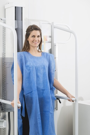 Woman In Blue Protective Clothing Undergoing X-ray Scan