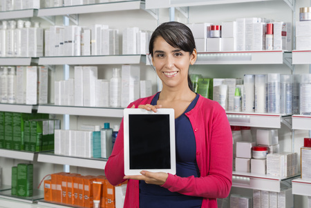 Customer Holding Tablet Computer With Blank Screen In Pharmacy