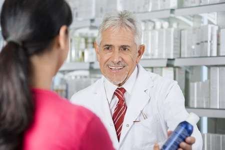 Pharmacist Selling Deodorant To Woman