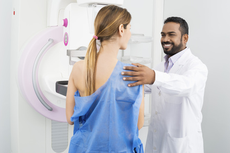 Doctor Preparing Patient For Mammogram Test