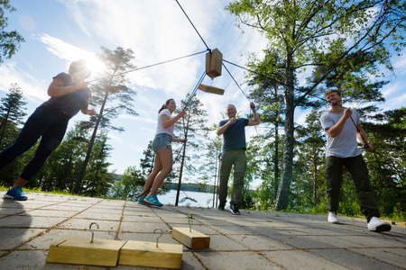Males And Females Picking Wooden Blocks With Ropes