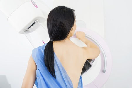 Woman Undergoing Mammogram X-ray Test In Clinic
