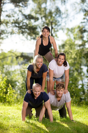 Portrait Of Multiethnic Business People Making Human Pyramid On
