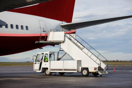 Vehicle By Gangway Attached To Airplane