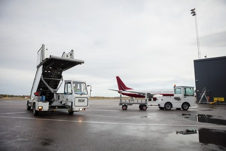 Mobile Gangway At Airport Against Sky