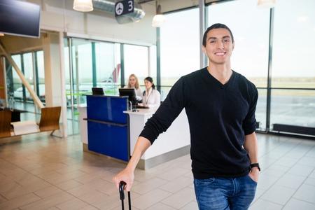 Portrait Of Smiling Male Passenger At Airport Archivio Fotografico
