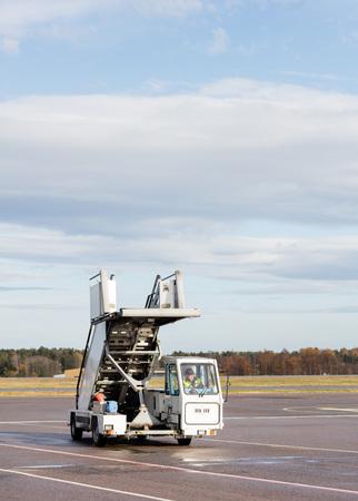 Gangway Moving On Wet Airport Runway Reklamní fotografie