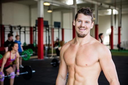 Confident Muscular Man Standing In Gym