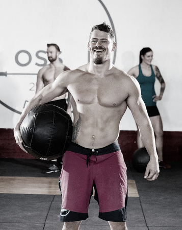 Muscular Male Carrying Medicine Ball