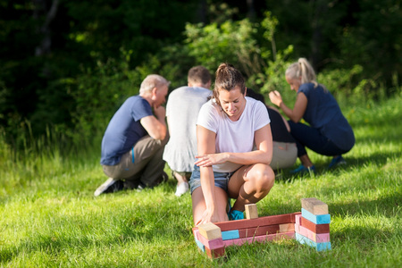 Woman explaing block pattern to team