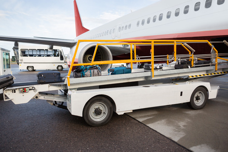 Luggage On Conveyor Belt Being Unloaded