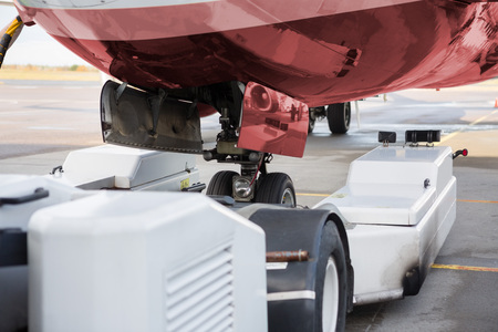 Towing Machine And Airplane On Runway 版權商用圖片