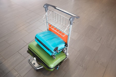Luggage In Trolley At Airport Standard-Bild