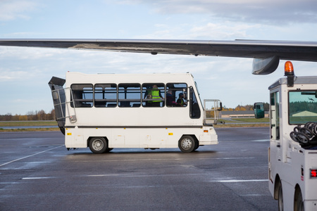 Passenger Bus Parked On Wet Airport Runway