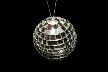 above shot of a disco ball decoration over a black background photo