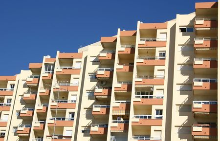 large apartment block against a blue sky