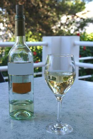 drank: glass of wine with an almost drank bottle of wine Stock Photo