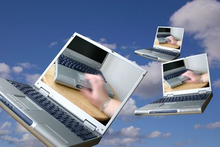 powerbook: incoming mail laptops floating through the air Stock Photo