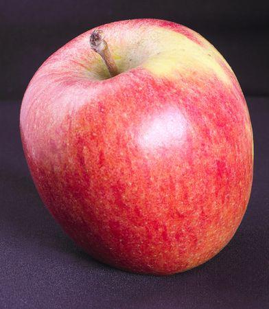 succulent crisp red apple against a dark background photo