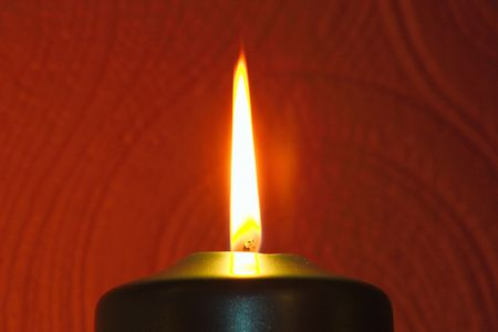 remembering: closeup of a large candle flame