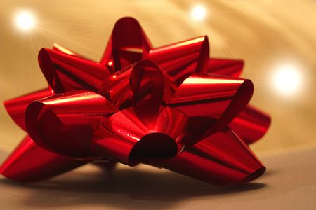 shiney: foil bow and lights background Stock Photo