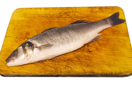 sea bass on a board isolated over white photo