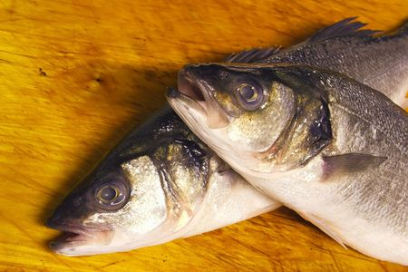 whitefish: fish heads on a wooden board
