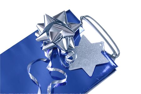 gift bag and silver bow and label isolated over a white background