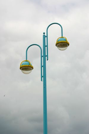 blue street lamp over a cloudy background photo