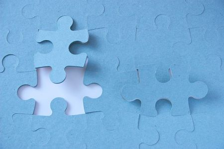 jigsaw puzzle with a piece missing and two pieces angled out Stock Photo