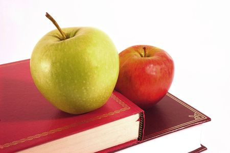 learnt: two apples on two books closeup