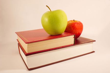 two apples on two books