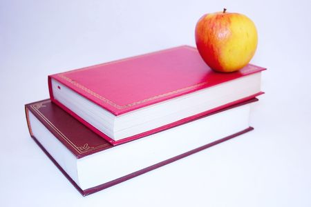 learnt: apple on two books over a light background Stock Photo