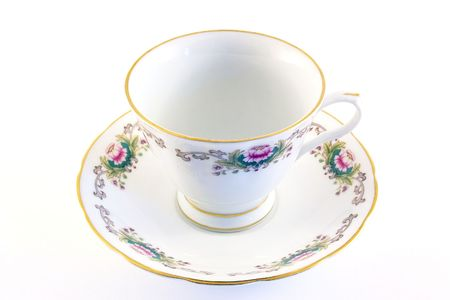 breakable: china cup and saucer isolated over a white background