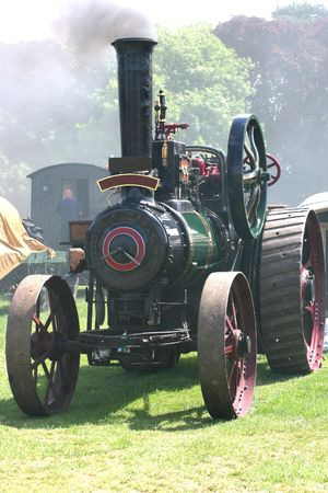 green traction engine at a steam rally