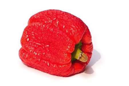 sumptious: withered pepper over white background Stock Photo