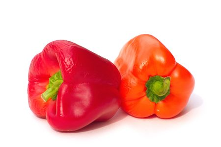 sumptious: red and orange bell peppers over a white background