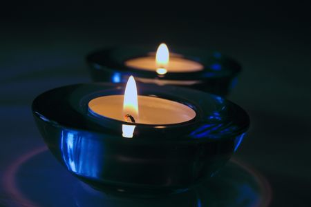 wicks: two candles in glass holders