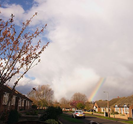 clouding: rainbow just forming at the bottom of the road