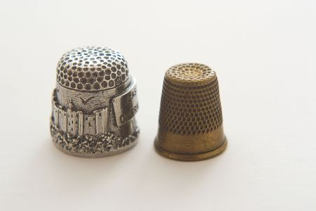 new silver and old brass thimbles