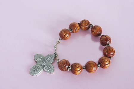 small rosary of metal crucifix and wooden beads photo