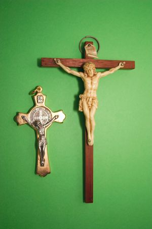 two crucifixes over a green background photo
