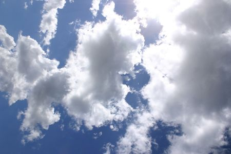 cottonwool: clouds and blue sky with the sun behind