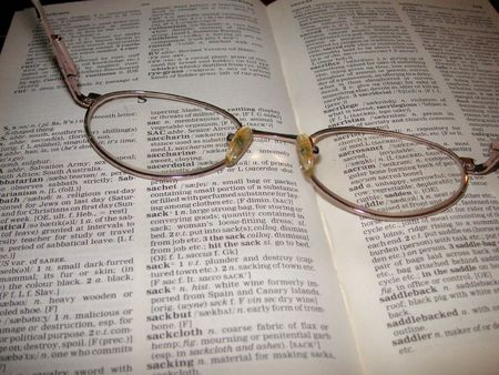 glasses on dictionary photo